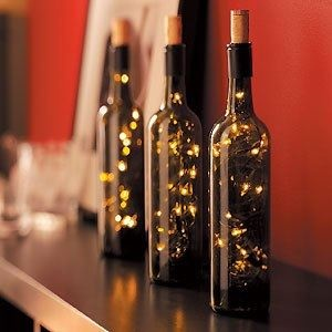 glowing wine bottles with christmas lights