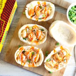 Slow Cooker Buffalo Chicken Mini Taco Boats