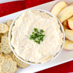 This Apple Cinnamon Cheddar Cheese Dip is a fun and unique twist on your classic cheddar cheese dip. Simple to make and full of flavor, it's perfect for holiday parties or get-togethers. Serve with your favorite crackers, pretzels, or apple slices and watch it disappear!