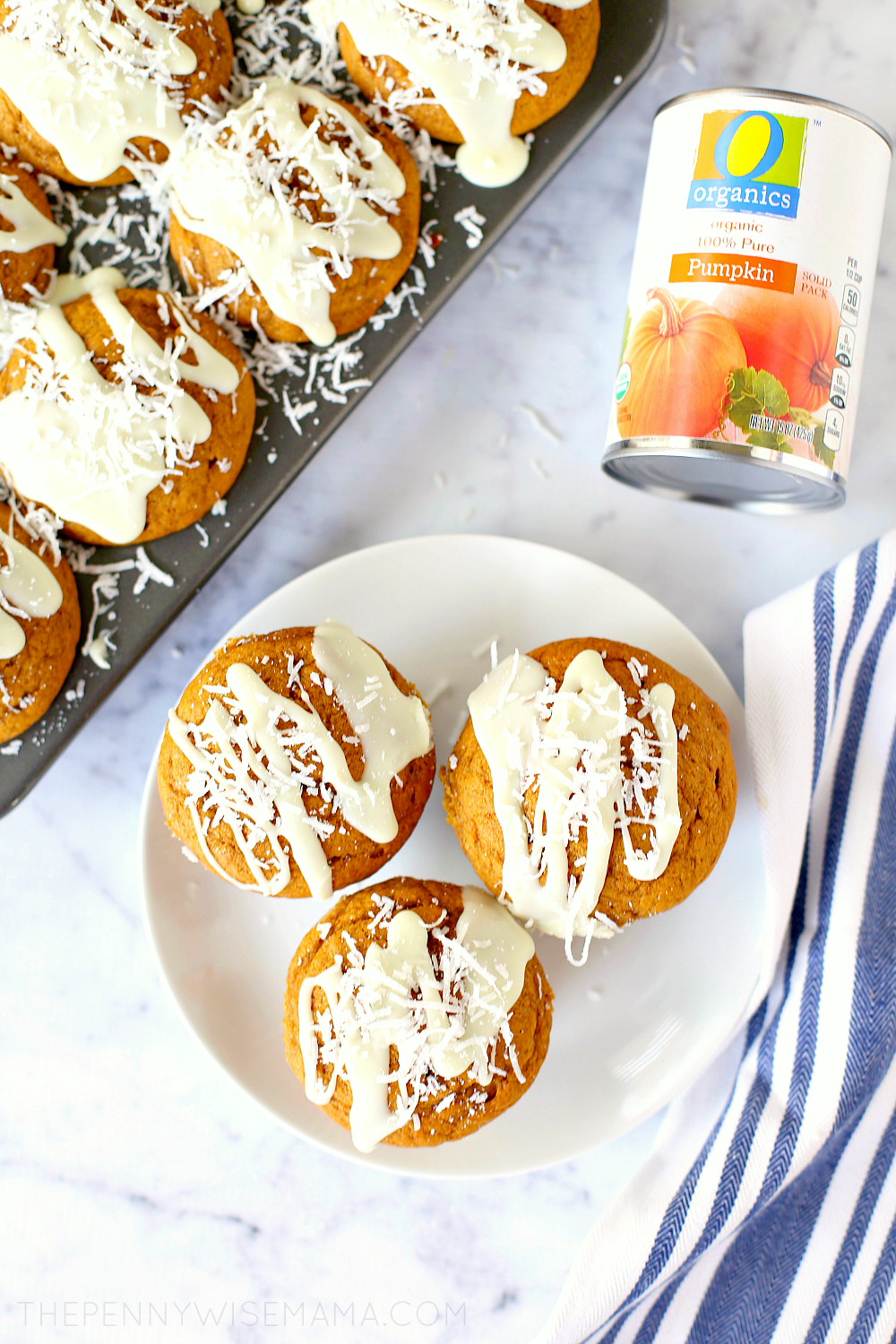 Pumpkin Muffins topped with white chocolate glaze and shredded coconut!