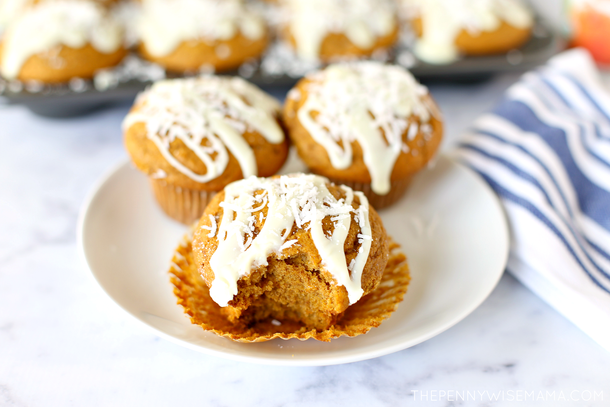 Delicious Pumpkin Muffins topped with white chocolate glaze and shredded coconut